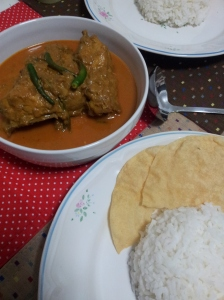 Kari Ayam with warm rice and pappadoms. Yummy.