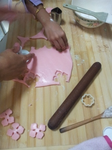 Cutting the kueh bangkit dough