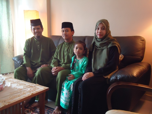 A family in Hari Raya clothes on the first day of Syawal celebrating Hari Raya Idul Fitri.