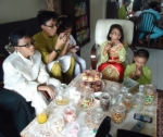 Children celebrating Hari Raya in an older relative's home.